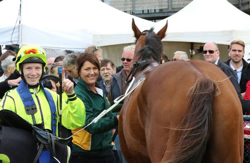 Jockey Damian Thonrton, strapper Sarah Woodhouse and a shy Reigning Meteor after winning at Warrnambool.